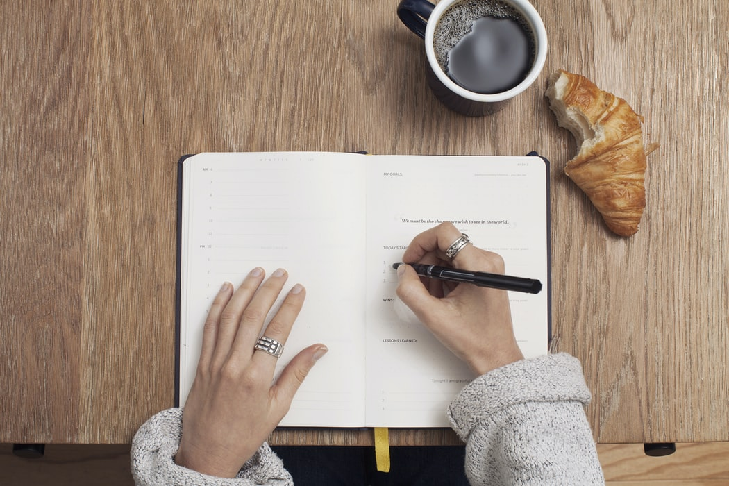 Woman writing in a journal to try and combat cognitive distortions like black and white thinking