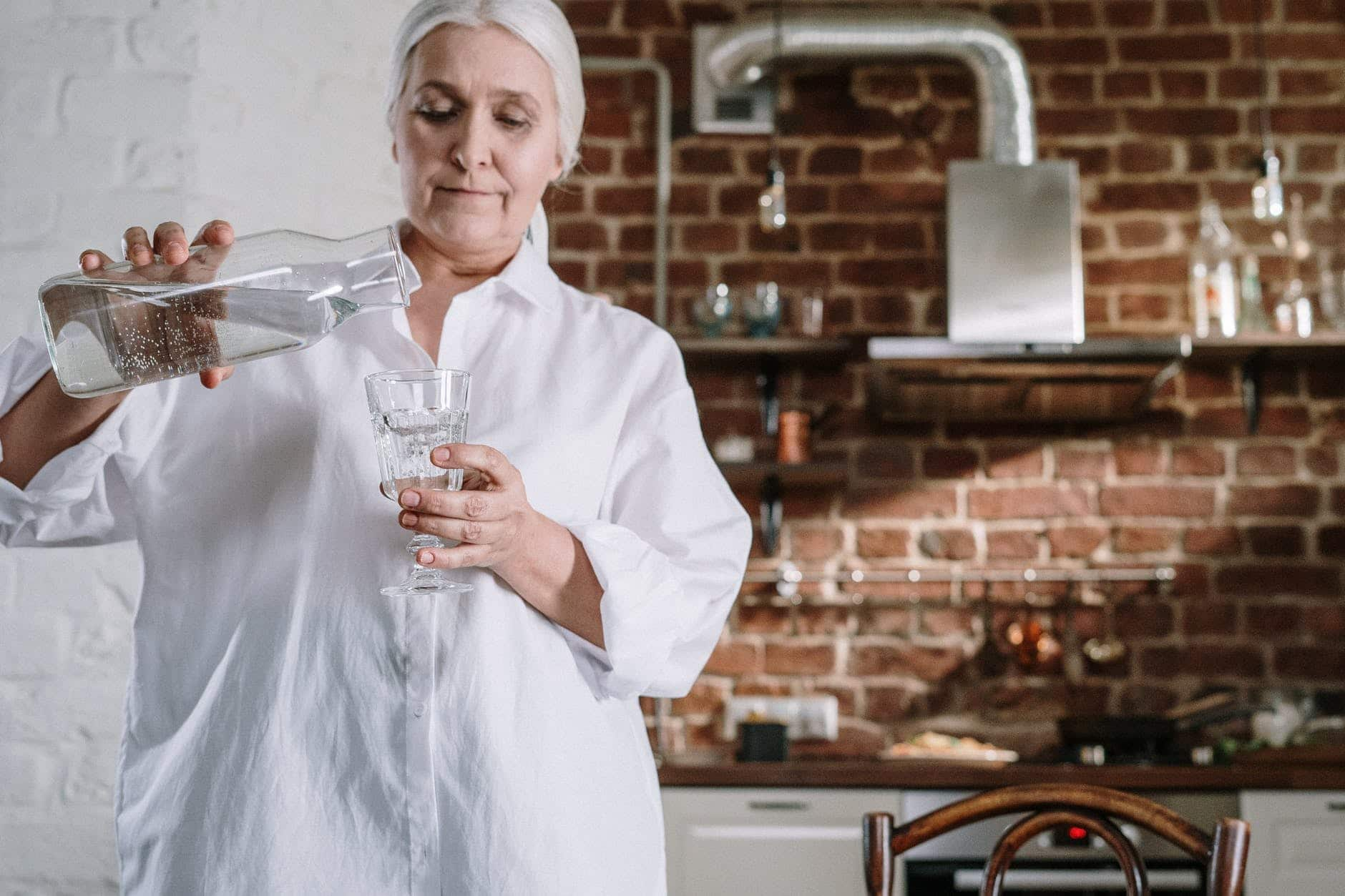 Woman pouring a glass of drinking water