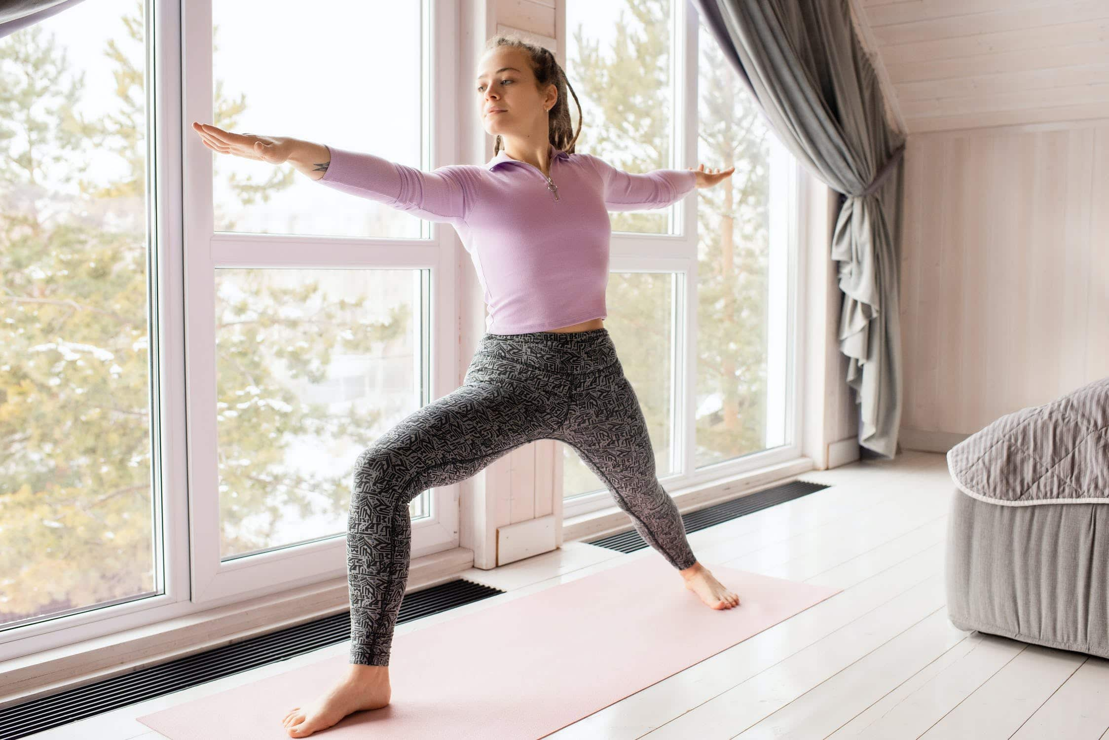Young woman practising yoga in the morning